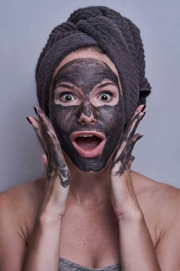 Woman wearing a charcoal face mask
